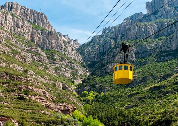 Obrázek lanovky jedoucí na Montserrat
